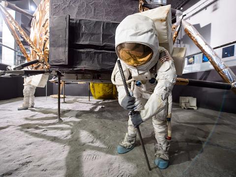 A model of an astronaut inside of the Lunar Lander