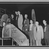 James K. Dobbs (third from right) and associates board a flight