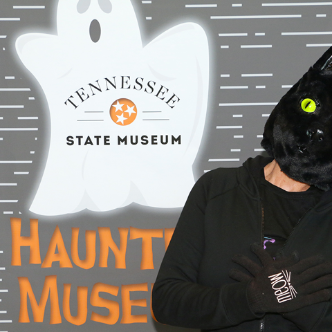 A Haunted Museum participant poses in the photo booth.