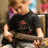 This young camper is learning how to rock