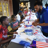 Kids lined up to create patriotic crafts.