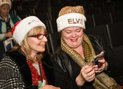 A gold Elvis-inspired Santa hat is a must-wear!