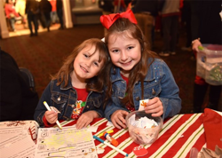 Kids created Christmas-inspired crafts in the ticket pavilion at the Lighting Ceremony.