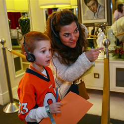 Fans participate in the Graceland Trivia scavenger hunt during the 2014 Birthday Celebration.