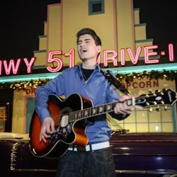 David Thibault performs inside the Elvis Presley Car Museum.