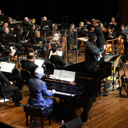 The Memphis Symphony Orchestra jams out to Elvis music during the annual Elvis Pops Concert.