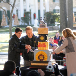 Special guests help cut the cake during the 2014 Birthday Celebration.