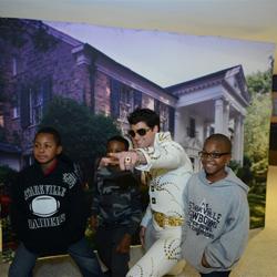 Our Graceland ambassador snaps photos with Elvis fans attending the Memphis Grizzlies Elvis Night.