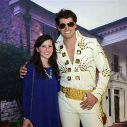 Graceland ambassador takes photos with Elvis fans during Elvis Night with the Memphis Grizzlies.