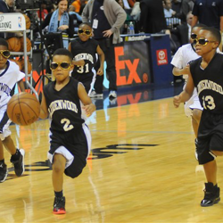 Tiny Elvis fans play during half-time at Elvis Night with the Memphis Grizzlies.
