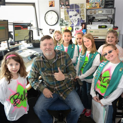 Girl scouts hang with Big Jim inside the Elvis Radio booth at Graceland.