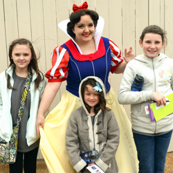 Scouts get a special surprise from Snow White during the 2014 Scouts Rock at Graceland.