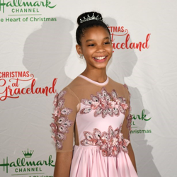 Madison Alsobrook who stars in Christmas at Graceland smiles for photographers on the red carpet.
