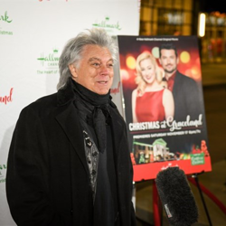 Country star Marty Stuart walked the red carpet at the Christmas at Graceland premiere.