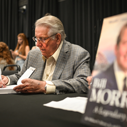 Bill Morris signed copies of his book after the panel.