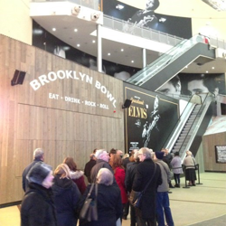 Fans line up for the opening day of Elvis at The O2 in London on December 12, 2014.