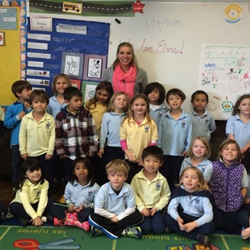 Missy Fleshman and one of her three classes of kindergarten students at The Magellan International School in Austin, Texas. The students created birthday cards for Elvis.