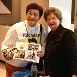 Evelyn Helms, who attended middle school with Elvis, greeted fans at the Fan Club Presidents