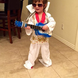 Jevin is dressed up like his favorite singer, Elvis.