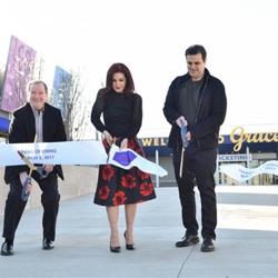 Graceland CEO Jack Soden, Priscilla Presley and Graceland Holdings Managing Partner Joel Weinshanker cut the ribbon at the Elvis Presley