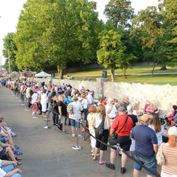 Fans line the gates of Elvis Presley