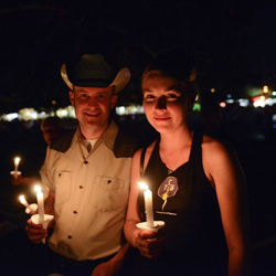 Fans light their candles in quiet remembrance of Elvis Presley during the 2014 Candlelight Vigil.
