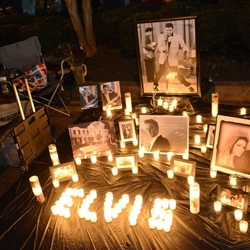 Fans set up tributes to the king during the 2014 Candlelight Vigil.