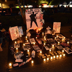 Elvis tributes line Elvis Presley Boulevard during the 2014 Candlelight Vigil.