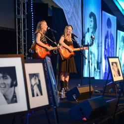 Gladys and Maybelle take the stage during the VIP reception on August 16, 2014.