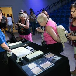 Fans get up close and personal with several artifacts during their Graceland Archives Experience.
