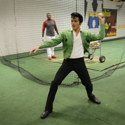 Memphis Redbirds help out the 2013 Ultimate Elvis Tribute Artist Dean Z before throwing the first pitch.