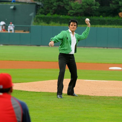 The 2013 Ultimate Elvis Tribute Artist Dean Z throws the first pitch during Elvis Night with the Memphis Redbirds.