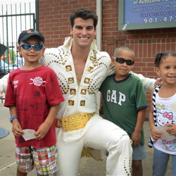 Little Elvis fans have their photo taken with the Graceland ambassador during Elvis Night at the Memphis Redbirds.