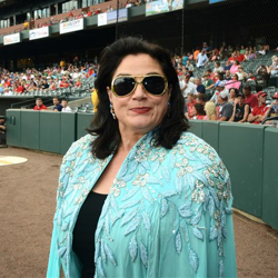 Decked out like a queen soprano Kallen Esperian gets ready to perform the National Anthem during Elvis Night at the Memphis Redbirds.