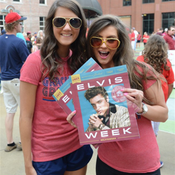The Red Hots pass our Elvis Week event guides during Elvis Night with the Memphis Redbirds.