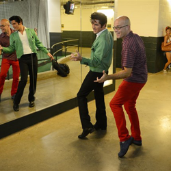 Dean Z gives dance lessons to Elvis Week blogger John Waterhouse.