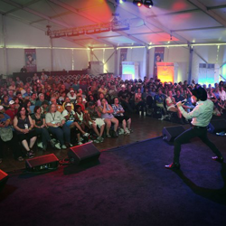 This Elvis tribute artist entertains the crowd during the Ultimate Elvis Tribute Artist Showcase on August 11, 2014.
