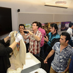 Graceland Director of Archives Angie Marchese shows a few Elvis artifacts to the Ultimate ETA Contest Semifinalists.