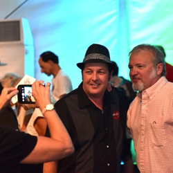Host Tom Brown greets fans at Elvis Week.