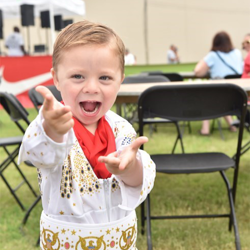 The littlest Elvis fans cheered on the runners at the Elvis Presley 5k.