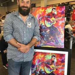 Artist Blend Cota, Creative Director for Thomas Kinkade Studios, unveiled his new Elvis artwork at Elvis Presley