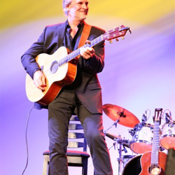 Andy Childs hosted A Band of Legends Remembers Elvis concert event.
