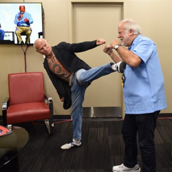 """Bill """"Superfoot"""" Wallace and Charles Stone pal around backstage during Elvis Week."""