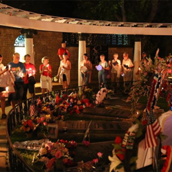 Thousands of Elvis fans participate in the Candlelight Vigil each year.