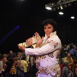 Winner Gordon Hendricks shows off the 2017 Ultimate Elvis Tribute Artist belt.