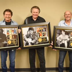 Songwriters Mac Davis, Mark James and Mike Stoller show off the awards they received during the Songwriters Showcase.