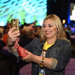 An Elvis fan takes a selfie at the Elvis Fan Reunion.