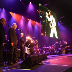 Elvis Live in Concert featured the king on the big screen and a live band.