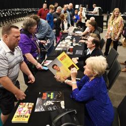 Fans line up for autographs at Elvis Week.