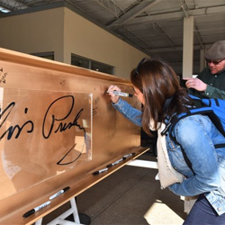 The gold beam was signed by Graceland guests and employees and Guest House construction workers the day before the Topping Out Ceremony.